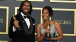 """Matthew A. Cherry, left, and Karen Rupert Toliver, winners of the award for best animated short film for """"Hair Love"""", pose in the press room at the Oscars on Sunday, Feb. 9, 2020, at the Dolby Theatre in Los Angeles. (Photo by Jordan Strauss/Invision/AP)"""