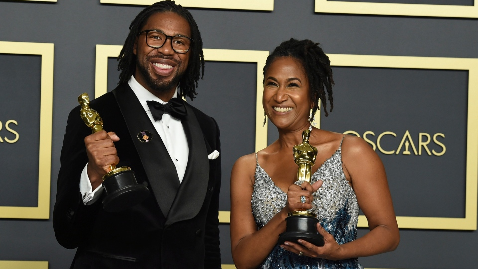 Matthew A. Cherry, left, and Karen Rupert Toliver, winners of the award for best animated short film for