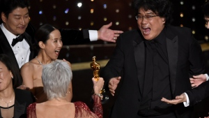"Bong Joon Ho, right, reacts as he is presented with the award for best picture for ""Parasite"" from presenter Jane Fonda at the Oscars on Sunday, Feb. 9, 2020, at the Dolby Theatre in Los Angeles. (AP Photo/Chris Pizzello)"