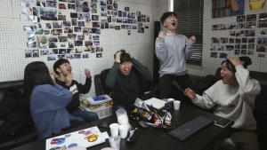 "Film club members celebrate as they watch a TV live broadcasting of South Korean director Bong Joon Ho's ""Parasite"" receiving the award for best picture at the Oscars, at the Yeonsei University in Seoul, South Korea, Monday, Feb. 10, 2020. (AP Photo/Ahn Young-joon)"
