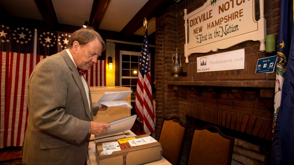 Town moderator Tom Tillotson arrives with ballots Monday, Nov. 7, 2016, as voters in Dixville Notch, get ready to cast their votes at midnight in Dixville Notch, N.H. (AP Photo/Jim Cole)