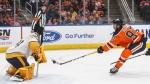 Nashville Predators goalie Juuse Saros (74) makes the save on Edmonton Oilers' Connor McDavid (97) during second period NHL action in Edmonton, Saturday, Feb. 8, 2020. THE CANADIAN PRESS/Jason Franson