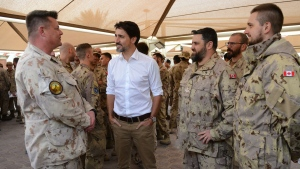 Prime Minister Justin Trudeau visits with Canadian troops at Camp Canada at Ali al Salem Air Base in Kuwait on Monday, Feb. 10, 2020. THE CANADIAN PRESS/Sean Kilpatrick