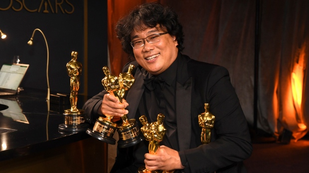 Bong Joon-ho holds the Oscars for best original screenplay, best international feature film, best directing, and best picture for 'Parasite' at the Governors Ball after the Oscars on Sunday, Feb. 9, 2020, at the Dolby Theatre in Los Angeles. (Richard Shotwell/Invision/AP)