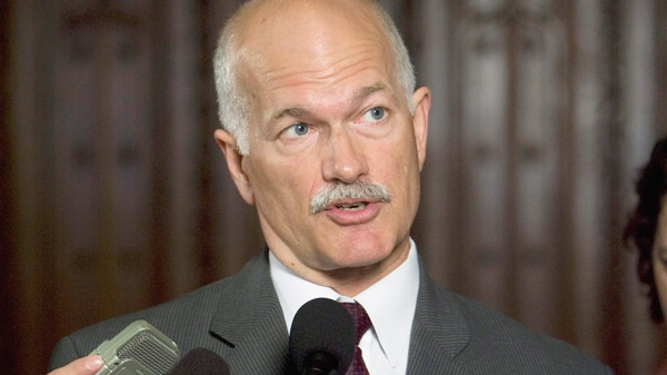 New Democrat Leader Jack Layton speaks with the media after voting in favour of the government motion to implement measures from the last budget in the House of Commons on Parliament Hill in Ottawa, Friday, Sept. 18, 2009. (Sean Kilpatrick / THE CANADIAN PRESS)