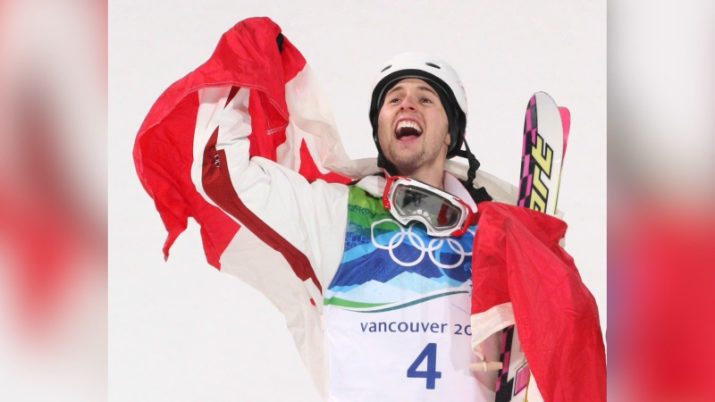 Alexandre Bilodeau celebrates his historic gold medal win at the 2010 Olympic Games in Vancouver. (The Canadian Press)