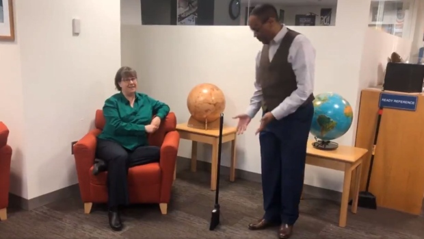 NASA astronaut Alvin Drew and scientist Sarah Noble try out the broomstick challenge in a Twitter video posted Tuesday, Feb. 11, 2020. (Source: Twitter)