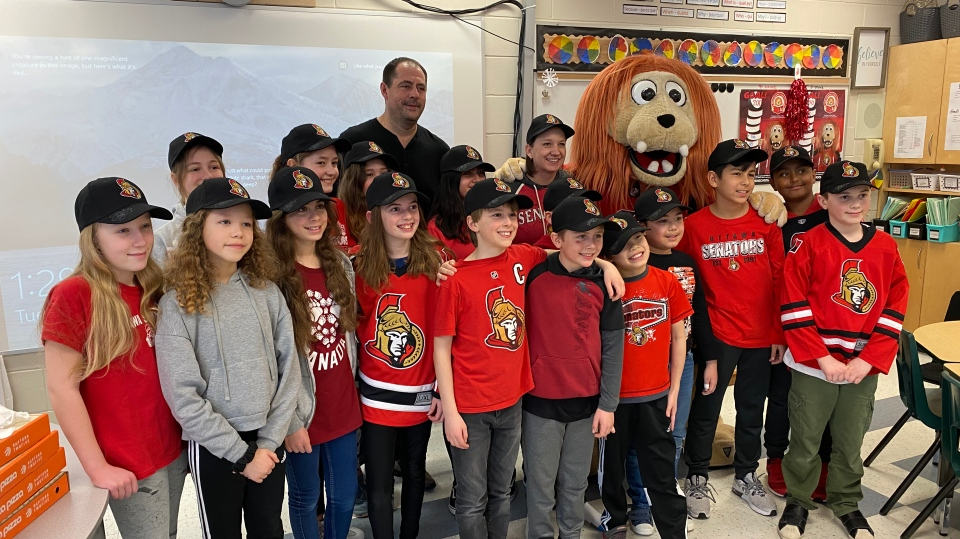 Students celebrate their 'Sparty Party' with Chris Phillips and Spartacat at Holy Cross Elementary School in Ottawa, Feb. 11, 2020 (Tyler Fleming / CTV News Ottawa)
