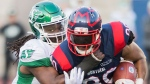 Montreal Alouettes' Spencer Moore, right, is tackled by Saskatchewan Roughriders' Solomon Elimimian during first half CFL football action in Montreal, Friday, August 9, 2019. THE CANADIAN PRESS/Graham Hughes