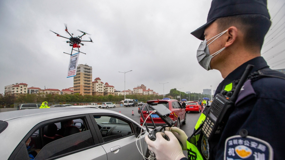 police officer operates a drone