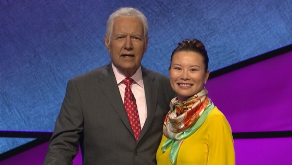 Calgary woman Kristyna Ng was a contestant on the gameshow Jeopardy!, seen here with the show's host Canadian Alex Trebek. (CTV)