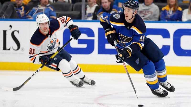 St. Louis Blues' Jay Bouwmeester, right, handles the puck as Edmonton Oilers' Gaetan Haas (91), of Switzerland, defends during the third period of an NHL hockey game Wednesday, Dec. 18, 2019, in St. Louis. The Blues won 2-1. (AP Photo/Jeff Roberson)