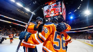 Edmonton Oilers' Adam Larsson (6) and Kailer Yamamoto (56) celebrate a goal against the Chicago Blackhawks during second period NHL action in Edmonton, Alta., on Tuesday February 11, 2020. THE CANADIAN PRESS/Jason Franson