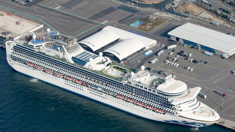 The U.S.-operated Diamond Princess is anchored as emergency vehicles stand by at Yokohama Port, near Tokyo, Wednesday, Feb. 12, 2020.(Kyodo News via AP)