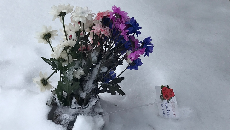 A bouquet left near the intersection of 34th Ave and 79th St.N.W. in Bowness following the death of Melissa Blommaert