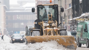 A plow prepares a street for snow clearing following a snowstorm in Montreal, Tuesday February 11, 2020. THE CANADIAN PRESS/Graham Hughes