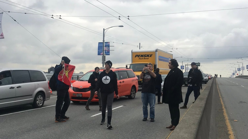 Drivers were trapped on the Granville Street Bridge as protesters blocked access to the crossing. (Mel Nagy/Twitter)