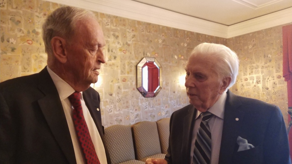 Former prime minister Jean Chretien (left), who was head of Indian and Northern Affairs during the October Crisis, speaks with W5's Lloyd Robertson on Dec. 17, 2019 (W5)