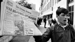 A newsboy holds up a newspaper with a banner headline reporting the invoking of the War Measures Act, in Ottawa, on Oct. 16, 1970 -- the first time Canada had invoked the act in peacetime. (THE CANADIAN PRESS / Peter Bregg)