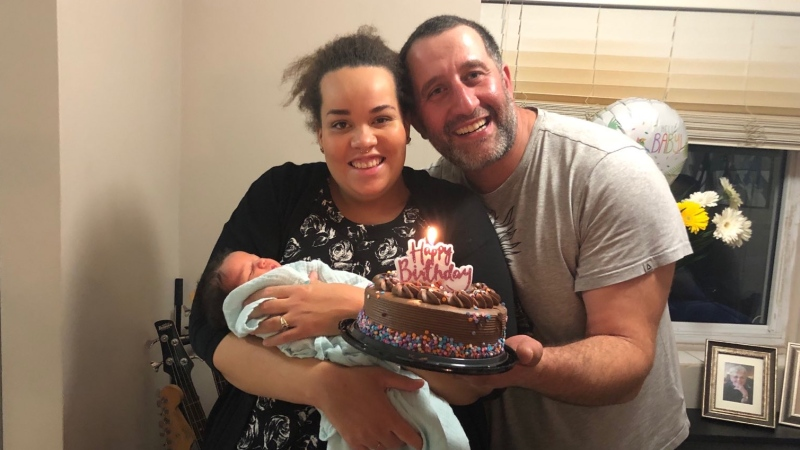 Jennifer Black-Sanadze and Levan Sanadze are seen with their newborn in this family photo.