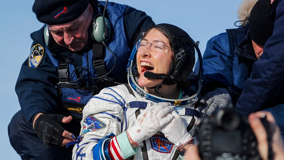 U.S. astronaut Christina Koch reacts shortly after the landing of the Russian Soyuz MS-13 space capsule about 150 km south-east of the Kazakh town of Zhezkazgan, Kazakhstan, Thursday, Feb. 6, 2020. (Sergei Ilnitsky/Pool Photo via AP)