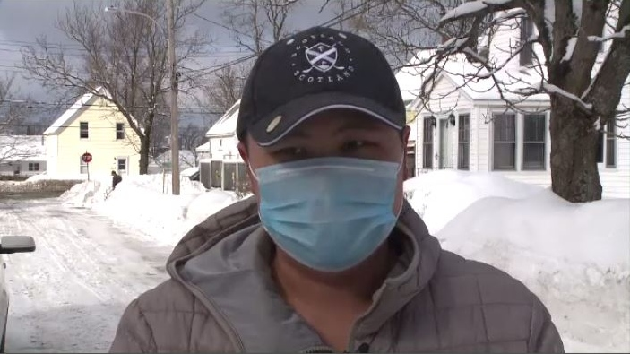Cape Breton University student Michael He wouldn't normally wear a mask while shovelling snow in Sydney, but he's being extra careful after returning five days ago from his home in China's Fujian Province.