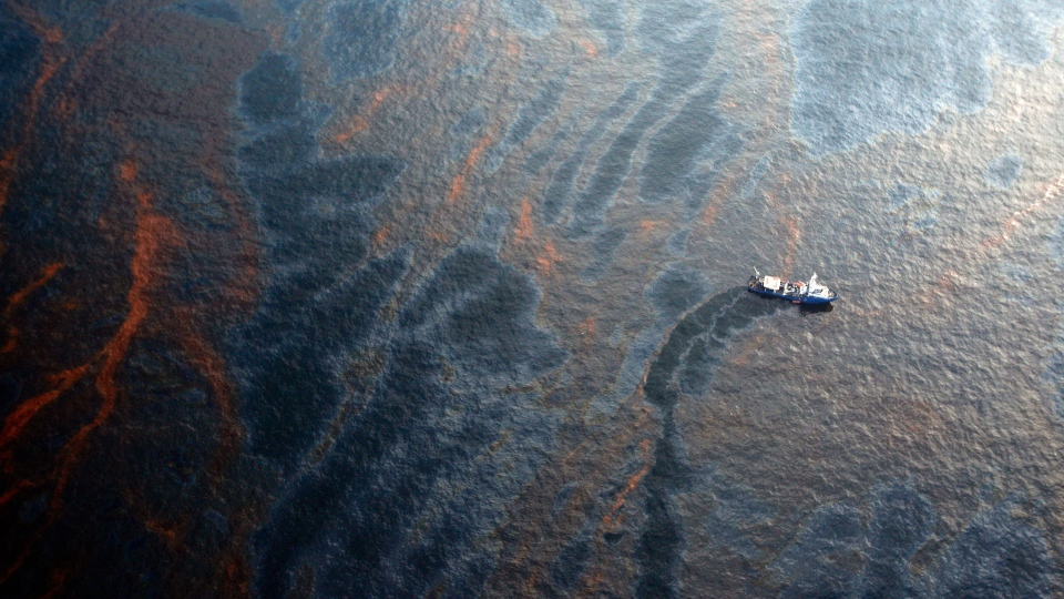 A boat works to collect oil that leaked from the Deepwater Horizon wellhead in the Gulf of Mexico near New Orleans on April 28, 2010, eight days after the explosion. (Chris Graythen/Getty Images)