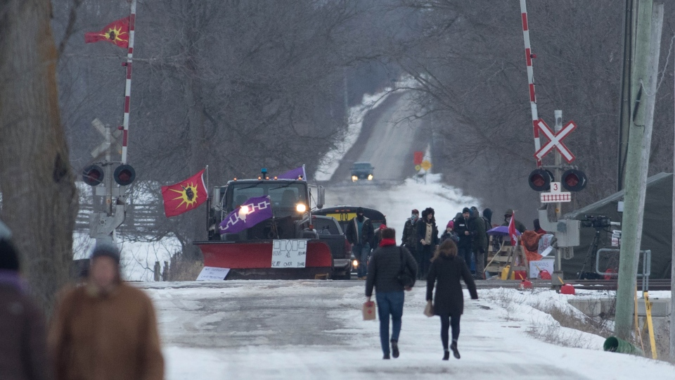 People arrive at the train track blockade in Tyendinaga Mohawk Territory near Belleville, Ontario, on Tuesday Feb. 11, 2020, in support of Wet'suwet'en's blockade of a natural gas pipeline in northern B.C. (THE CANADIAN PRESS / Lars Hagberg)