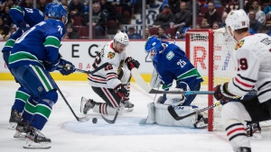 Vancouver Canucks goalie Jacob Markstrom (25), of Sweden, stops Chicago Blackhawks' Ryan Carpenter (22) during the third period of an NHL hockey game in Vancouver, on Wednesday February 12, 2020. THE CANADIAN PRESS/Darryl Dyck