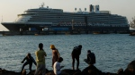 The Westerdam cruise ship, owned by Holland America Line, is docked at the port of Sihanoukville, Cambodia, Thursday, Feb. 13, 2020. (AP Photo/Heng Sinith)