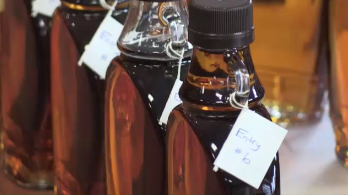 Maple syrup in bottles on a desk