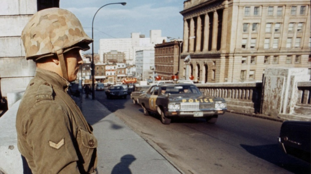 Soldiers of the Royal 22nd Regiment from Quebec City stand guard on one of the many bridges in Montreal after the War Measures Act was invoked on Oct. 16, 1970. (THE CANADIAN PRESS)