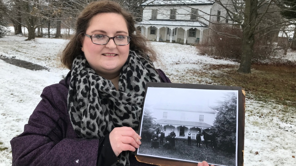 Angela Foreman-Bobier holds a photo of an original hotel, now a residence, in Coynes Corner, Ontario. (CTV News / Sean Irvine)