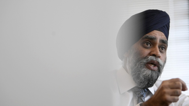National Defence Minister Harjit Sajjan is seen during an interview with The Canadian Press in his office at National Defence headquarters in Ottawa, Thursday, Dec. 12, 2019. THE CANADIAN PRESS/Adrian Wyld
