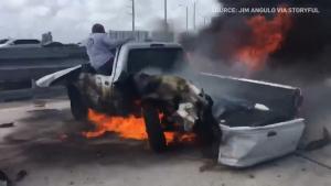 Cellphone video shows a driver trapped inside a pickup truck engulfed in flames that was involved in a collision on Interstate 95 in Miami. (Jim Angulo via Storyful/Feb. 12, 2020)