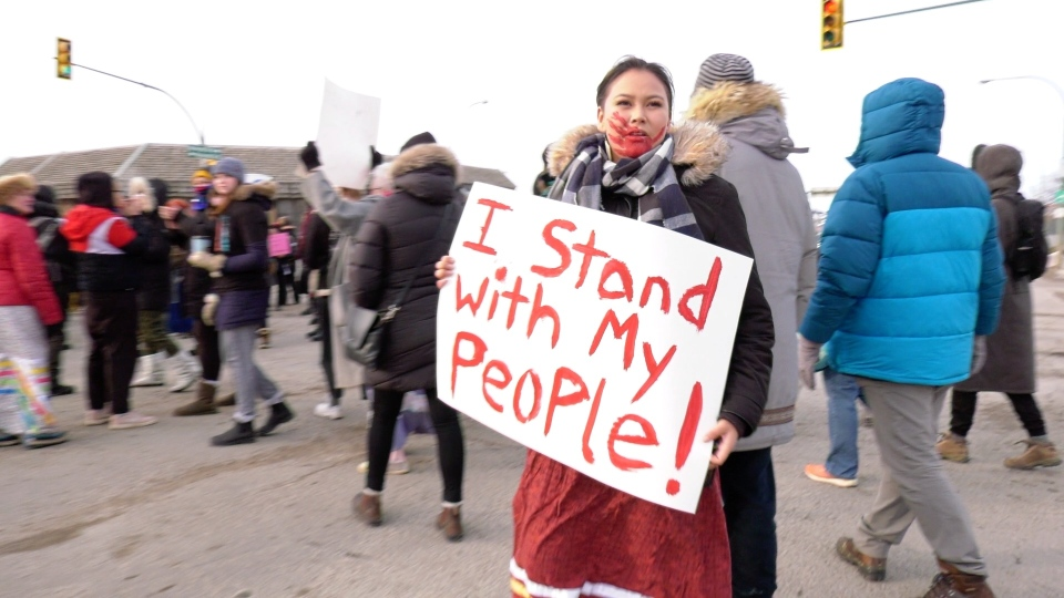 Krista Forsberg protests at the intersection of Idylwyld Drive and 22nd Street West on Feb. 13, 2020. (Laura Woodward/CTV Saskatoon)