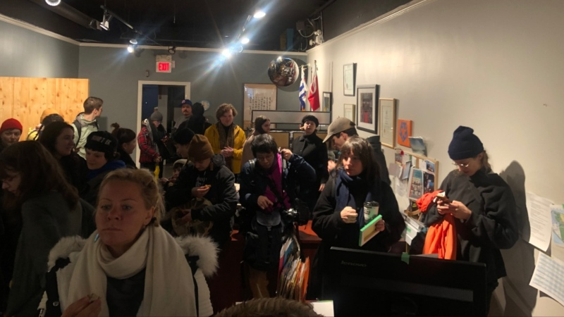 Protesters are seen occupying Attorney General David Eby's Vancouver office on Thursday, Feb. 13, 2020.