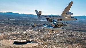 This photo provided by Virgin Galactic shows the Virgin Galactic's VSS Unity flying over Spaceport America in Truth or Consequences, NM on Thursday, Feb. 13, 2020. (Virgin Galactic via AP)