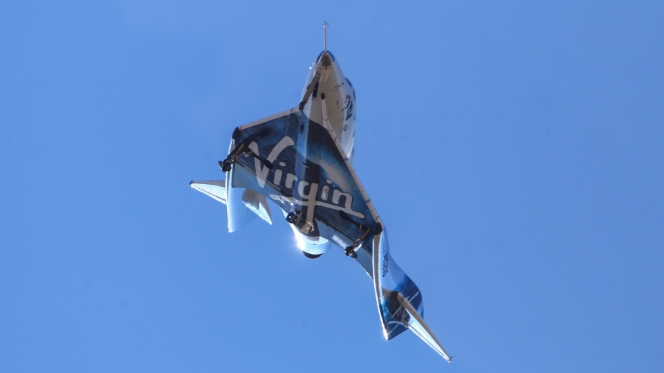 In this Friday, Feb. 22, 2019 file photo Virgin Galactic's VSS Unity returns to Mojave Air and Space Port after reaching space in Mojave, Calif. (AP Photo/Matt Hartman,File)