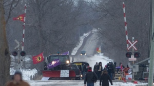 People arrive at the train track blockade in Tyendinaga Mohawk Territory near Belleville, Ontario, on Tuesday Feb. 11, 2020, in support of Wet'suwet'en's blockade of a natural gas pipeline in northern B.C. THE CANADIAN PRESS/Lars Hagberg