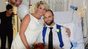 Melissa Oitzl and Brock Thom exchanged wedding vows while Thom awaited a high-risk, life-saving surgery at the Ottawa Heart Institute.