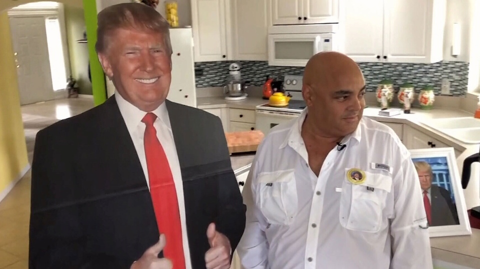 Nelson Gibson stands next to his cutout of U.S. President Donald Trump. He's been told he isn't allowed to bring the cutout to dialysis treatments. (WPBF 25)