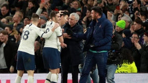 Tottenham's Son Heung-min, center left, celebrates with Tottenham's manager Jose Mourinho after scoring his side's second goal during the English Premier League soccer match between Tottenham Hotspur and Manchester City at the Tottenham Hotspur Stadium in London, England, Sunday, Feb. 2, 2020. (AP Photo/Ian Walton)