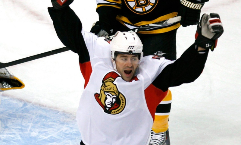 Ottawa Senators' Chris Phillips, front, celebrates a goal by teammate Daniel Alfredsson, of Sweden, in front of Boston Bruins' Tim Thomas, left, and Derek Morris in the first period of an NHL hockey game, Monday, Jan. 18, 2010, in Boston. (AP / Michael Dwyer)