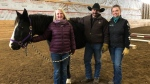 Randi Belliveau, Todd McNeice and Tanya McNeice stand with Journey at Double T Ranch