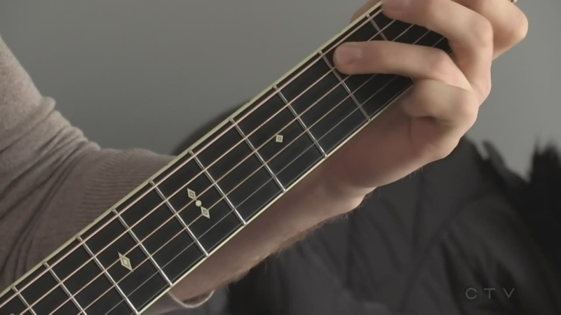 Justin Macki plays his guitar. (Jordyn Read / CTV London)