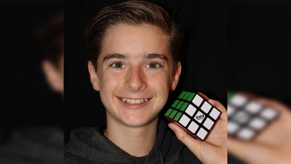 Riley Gellatly poses with a Rubik's Cube