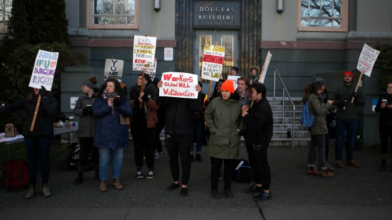 Wet'suwet'en supporters and Coastal GasLink opponents protest 20 government buildings throughout Victoria, Friday, Feb. 14, 2020. THE CANADIAN PRESS/Chad Hipolito