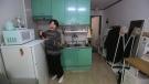 Kim Da-hye, a 29-year-old South Korean, talks about her semi-basement apartment in Seoul, South Korea, Saturday, Feb. 15, 2020. (AP Photo/Ahn Young-joon)
