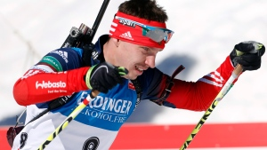 In this file photo dated Sunday, March 9, 2014, Russia's Evgeny Ustyugov competes in the men's 15km mass start at the biathlon World Cup competition in Pokljuka, Slovenia. The International Biathlon Union on Saturday Feb. 15, 2020, issued a two-year ban for Russia's Evgeny Ustyugov, who was part of the gold medal-winning men's relay team at the 2014 Sochi Winter Olympics. (AP Photo/Darko Bandic, FILE)